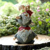 Stack of Miniature Garden Gnomes with Tiny Squirrel on Top