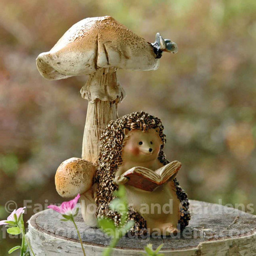 Miniature Hedgehog Sitting Under a Mushroom and Reading a Book