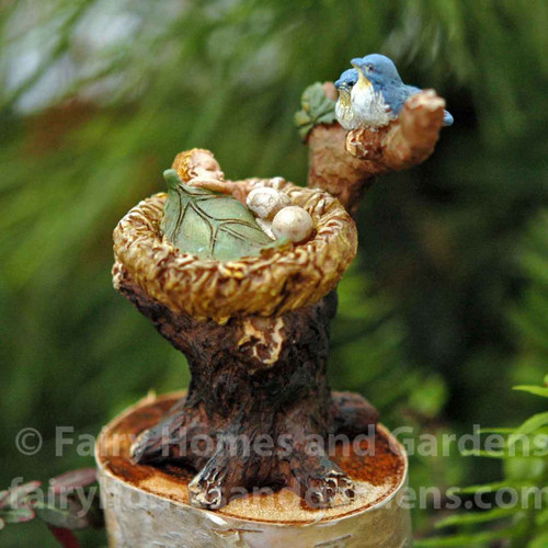 Tiny Bluebirds Watch Over a Baby Fairy