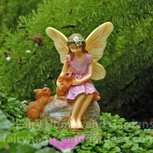 Miniature Fairy with Two Tiny Rabbits