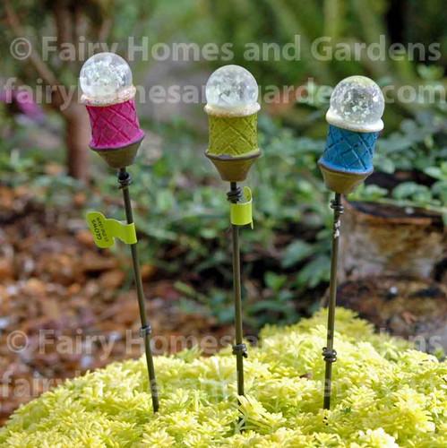 Set of three miniature tiki torches