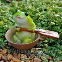 Miniature Froggie Rowing a Boat