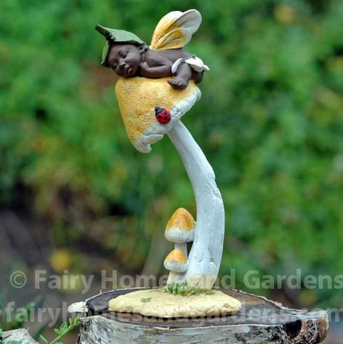 Miniature Ebony Fairy Sleeping on Mushroom