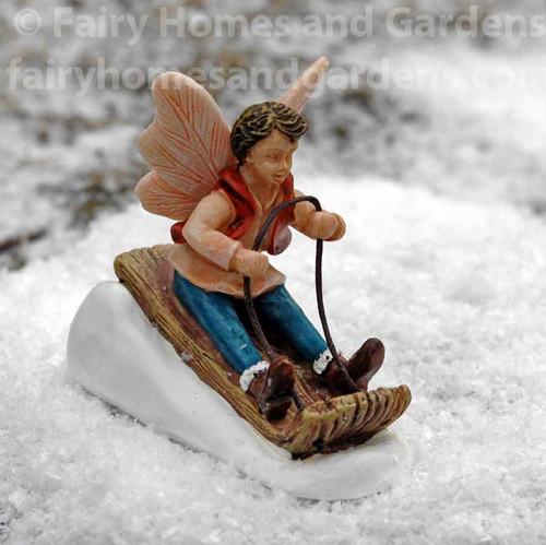 Miniature Fairy Boy on Toboggan