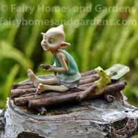Miniature Pixie Rowing a Raft with Tiny Frog