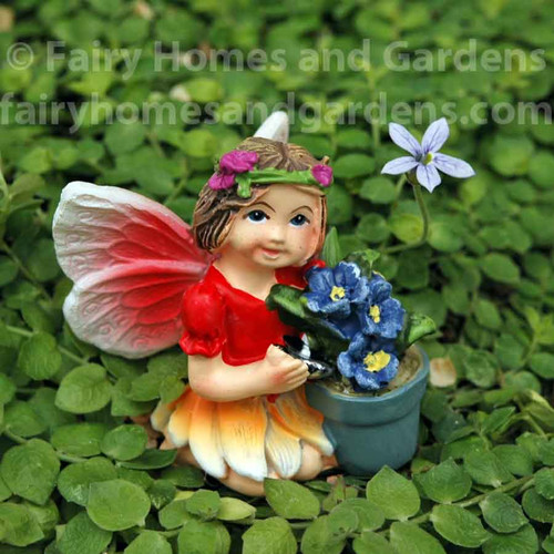 Miniature Fairy Tale Fairy Holding a Pot of Flowers