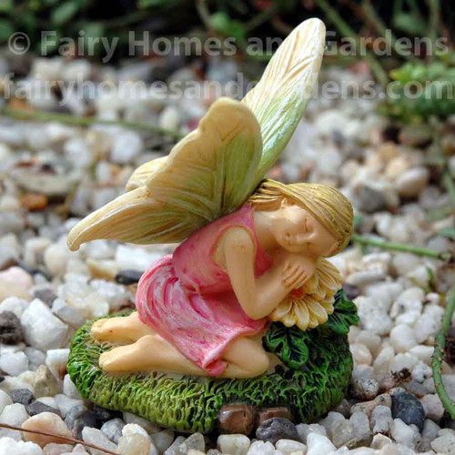 Woodland Knoll Fairy Resting on a Pillow of Flowers
