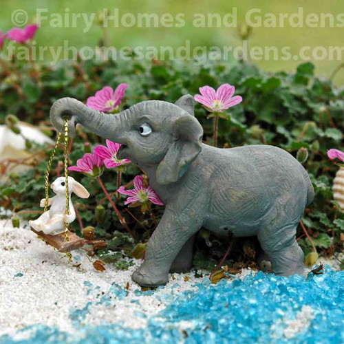 Miniature Elephant Swinging a Bunny