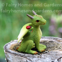 Miniature Green Dragon with Tiny Ladybug on His Shoulder
