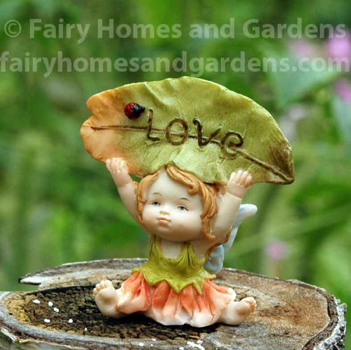 "Little Fairy Caroline Holding a ""Love"" Sign"