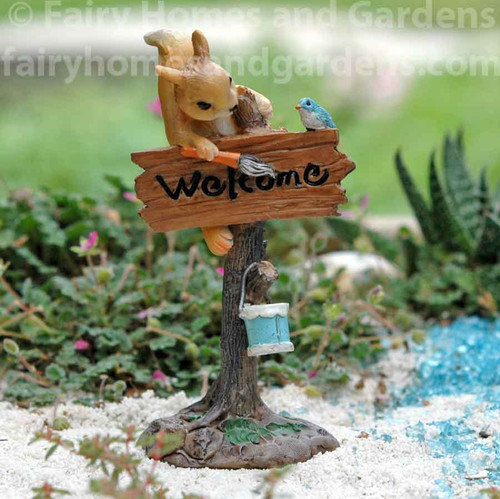 """Miniature Squirrel Painting a """"Welcome"""" Sign"""