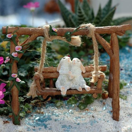 Miniature Rabbits on Garden Swing