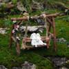 Miniature Loving Rabbits on Swinging Garden Bench
