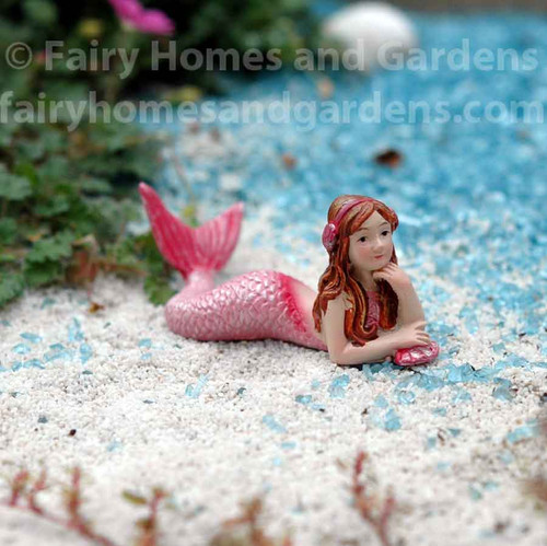 Miniature Mermaid Figurine Wearing Headphones