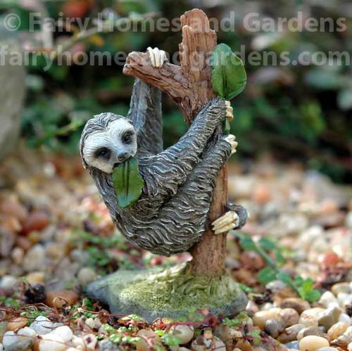 Miniature Sloth Eating Leaves