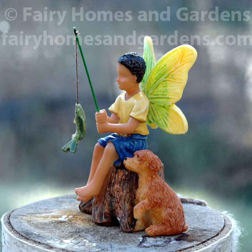 African American Fairy Boy Fishing with His Dog