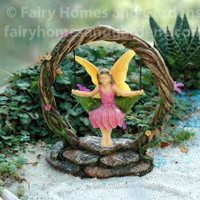 Woodland Knoll Fairy on a Leaf Swing
