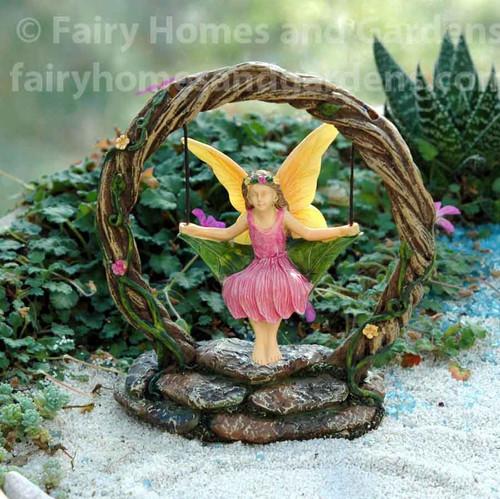 Woodland Knoll Fairy on a Leaf Swing