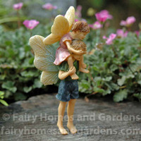 Miniature Fairy Girl Riding Piggyback on Fairy Boy
