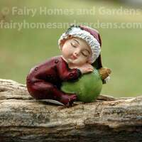 Christmas Baby with Green Ornament