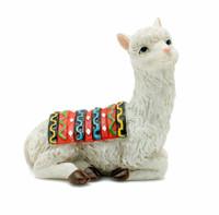 Miniature Kneeling Llama Figurine