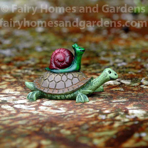 Miniature Snail Hitching a Ride With Turtle Figurine
