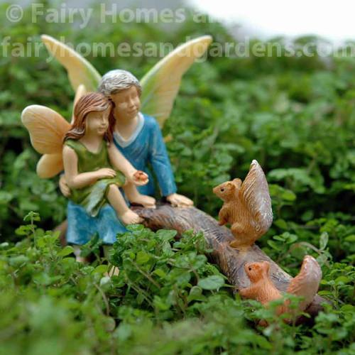 Grandma and Granddaughter Fairies Feeding the Squirrels