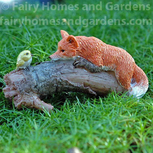 Playful Fox with Bird Figurine