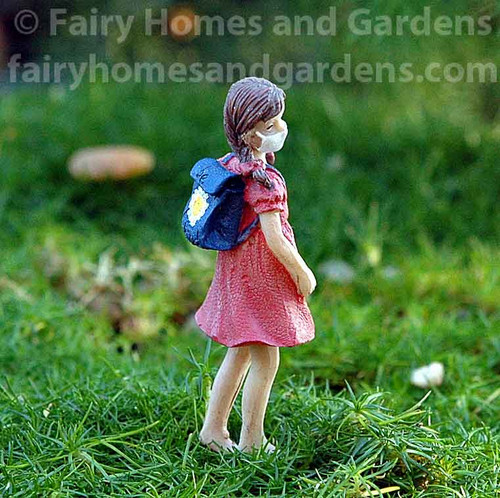 Miniature Girl Figurine with Mask and Backpack