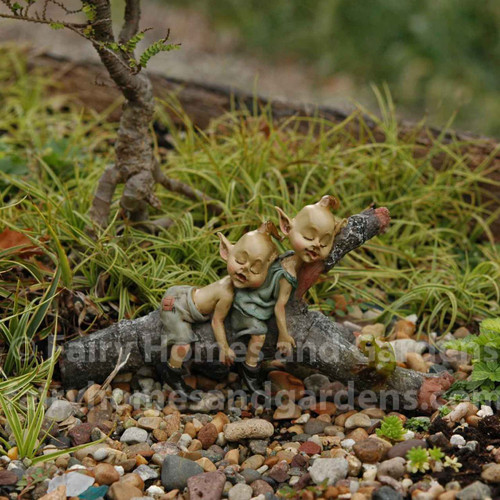 Twin Garden Pixies Napping on a Tree Log