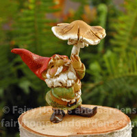 Miniature Gnome with a Pointy Red Hat and Toadstool Umbrella