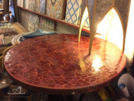 RED PINWHEEL ROUND TABLE