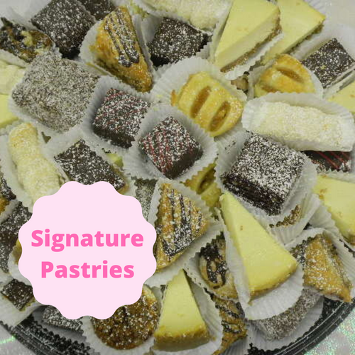 """A variety of our """"Signature Pastries"""" including the following: Brownies, Lady Locks, Kolacky, Coconut Bars, Strudels, Butter Cookies, Baklava, Peanut Butter Bars, and Pecan Tarts. These pastries are perfect for any occasion because they offer a variety of baked goods for everyone!"""