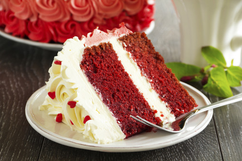 With its rosy-red complexion and traditional snow-white frosting, Red Velvet Cake is downright stunning.  Try the chocolate buttercream frosting for a black velvet cake!