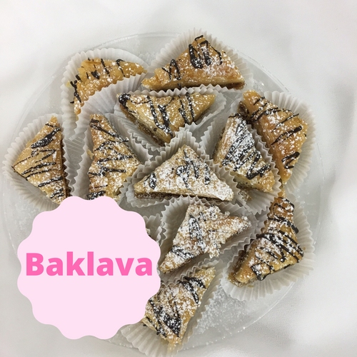 A rich dessert made with layers of thin pastry and filled with chopped nuts, butter, and cinnamon. Baked and soaked in a honey and sugar syrup and drizzled in chocolate for a simply delicious pastry.