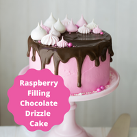 A moist yellow cake with raspberry filling creamy buttercream frosting and chocolate drizzle.