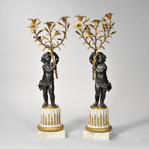 A Fine Pair of Gilt-bronze Figural Three-Light Candelabra