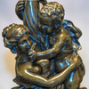 Pair of Patinated Bronze Figural Sculpture Torcheres