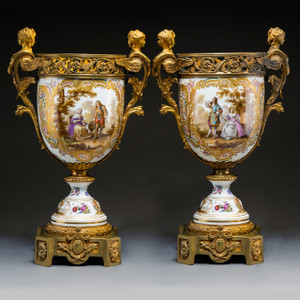 An Elegant Pair of Continental Gilt Bronze-Mounted Painted Porcelain Urns