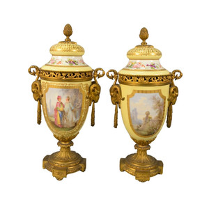 Fine Pair of Gilt Bronze Mounted Sèvres-style Yellow Porcelain Urns and Cover