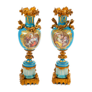 A Fine Quality Pair of Sèvres Style Ormolu Mounted Porcelain Urns with Cherubs
