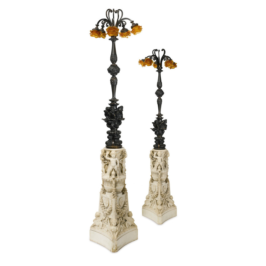 Pair of carved marble and patinated bronze floor lamps