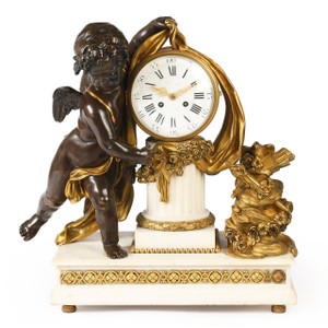 A beautiful French Louis XVI style gilt and patinated bronze mantel clock