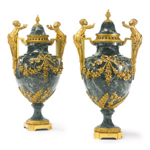 A large pair of 19th century Louis XVI style gilt-bronze mounted Patricia green marble urns