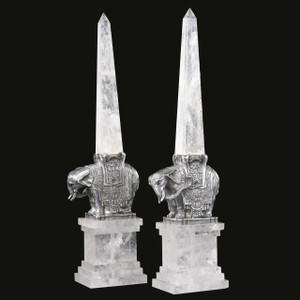 A fine pair of rock crystal obelisks on silvered bronze elephant form bases from the late 20th century