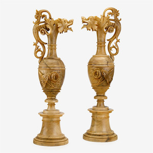 A pair of precious Italian alabaster ewers with elongated neck surmounted by a wyvern spout and scrolled handle