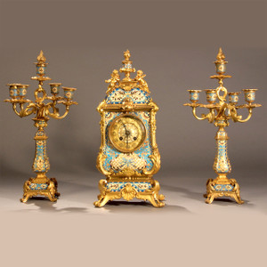A Fine and Attractive French Champleve gilt bronze and light blue champleve enamel clock set