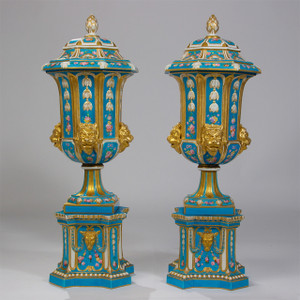 An Important Rare Pair of Sevres Gilded Porcelain Vases with Lion Heads and Hand Painted Flowers