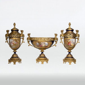 A Very Fine Three-piece Sèvres Gilt Bronze Mounted and Colbalt Hand Painted Porcelain Garniture