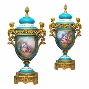 An Exquisite Pair of Sèvres Style Gilt Bronze Mounted Porcelain Vases